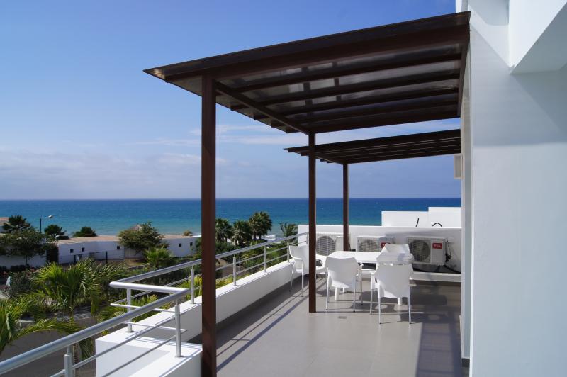 View of patio overlooking ocean