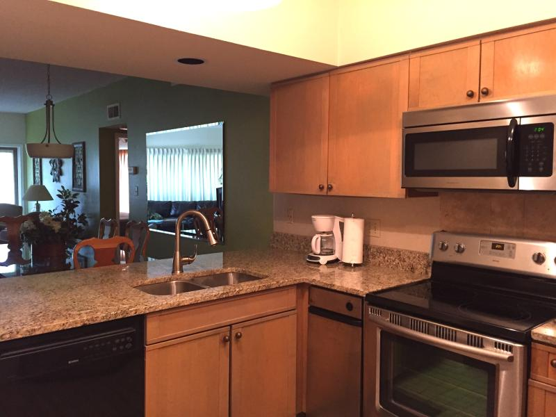 Kitchen has granite counter tops, stainless appliances, convection oven, trash compactor.
