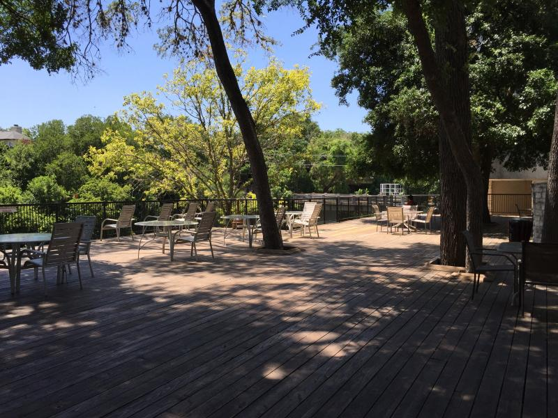 There is a large shaded wooden deck with tables and chairs for everyone.