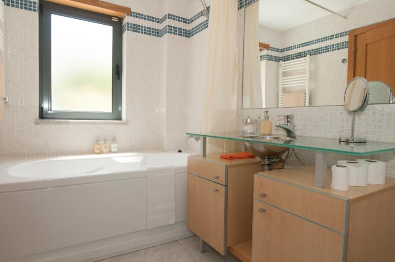 En-suite bathroom. Shampoo, conditioner and bath gel provided