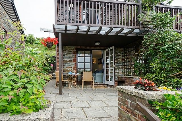 This adorable property is the perfect romantic getaway with a patio and balcony