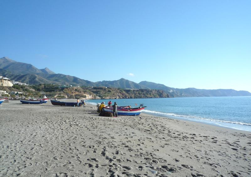 Burriana Beach very early showing fishermen preparing to go out &Y sometimes pos to buy fish