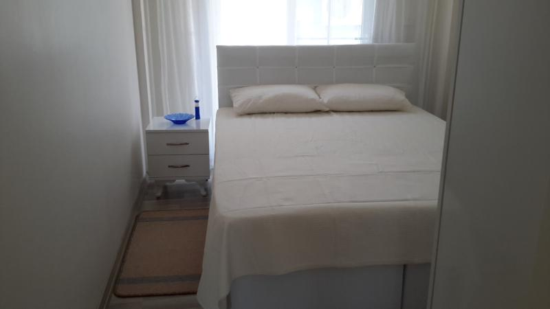 Bedroom with automatic blind.