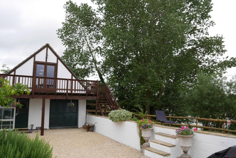 Games Annexe with Balcony overlooking the River with Table and chairs to soak up the amazing views .