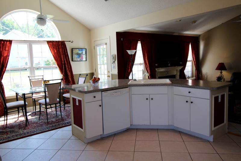 The open kitchen format makes it easy to participate in family activities.