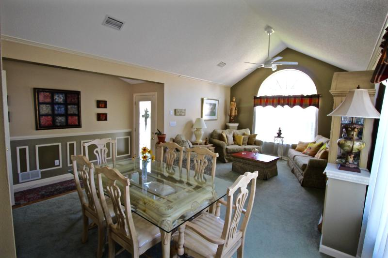 The front room is a cozy sitting area adjacent to the formal dining area.