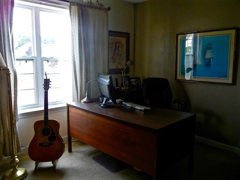 the third bedroom is currently set up as a double office.