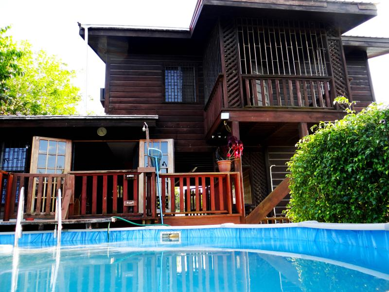View of house with upper-lower deck and pool