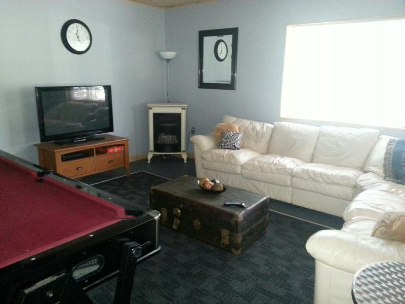 Watch a movie in the large game room..cozy warm fireplace