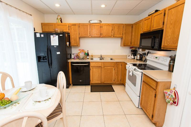 Kitchen which leads to the pool deck