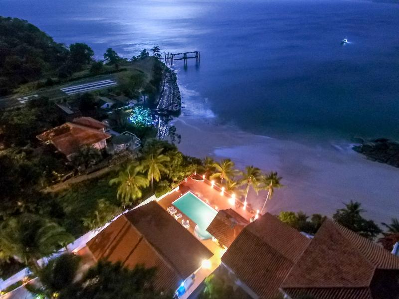 Midnight moon over the home of your next dream vacation. Let us take care of you