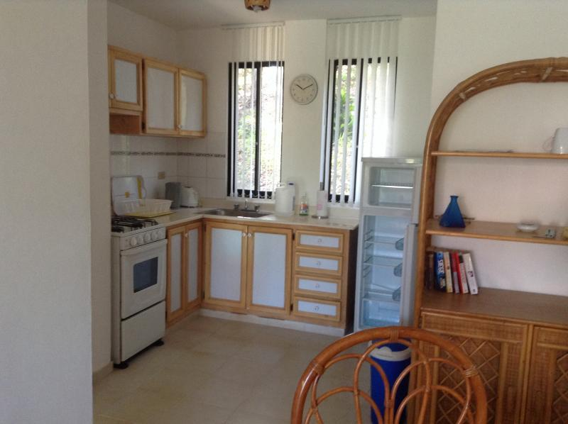 Full Kitchen with gas stove and microwave, toaster large fridge. pots n pans dishes and cutlery etc.