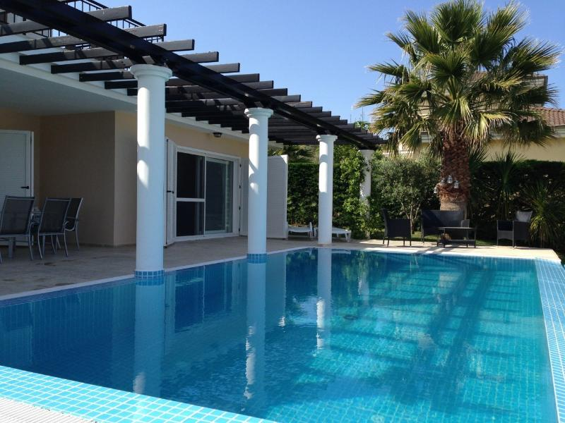 Private pool, tropical garden and many terraces in sun and shade