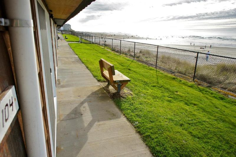 A grassy patio is just steps from the beach