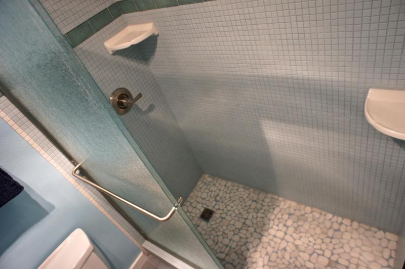 A tiled walk-in shower