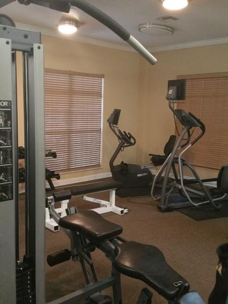 Fitness Room includes treadmills, elliptical, weights, open 24/7.