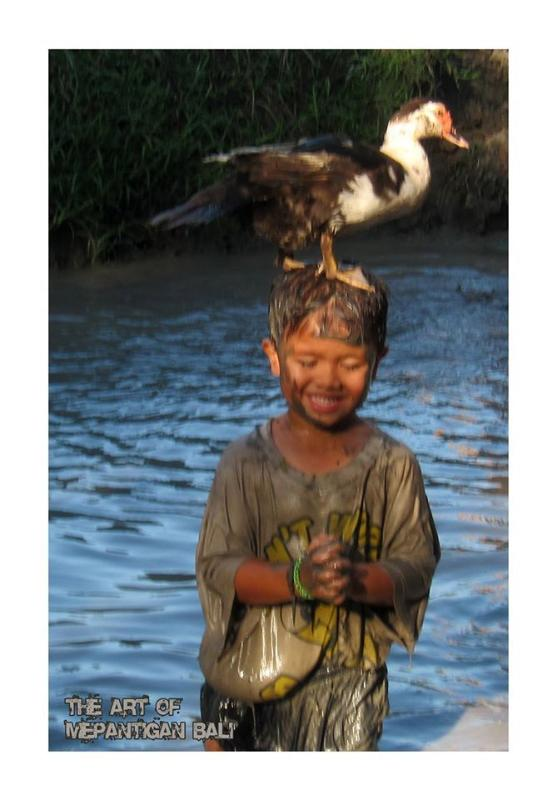 Children playing in the mud and loving the animals