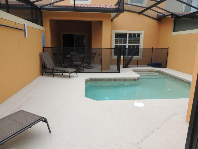 The screened private pool provides a refreshing dip after a long day of play.