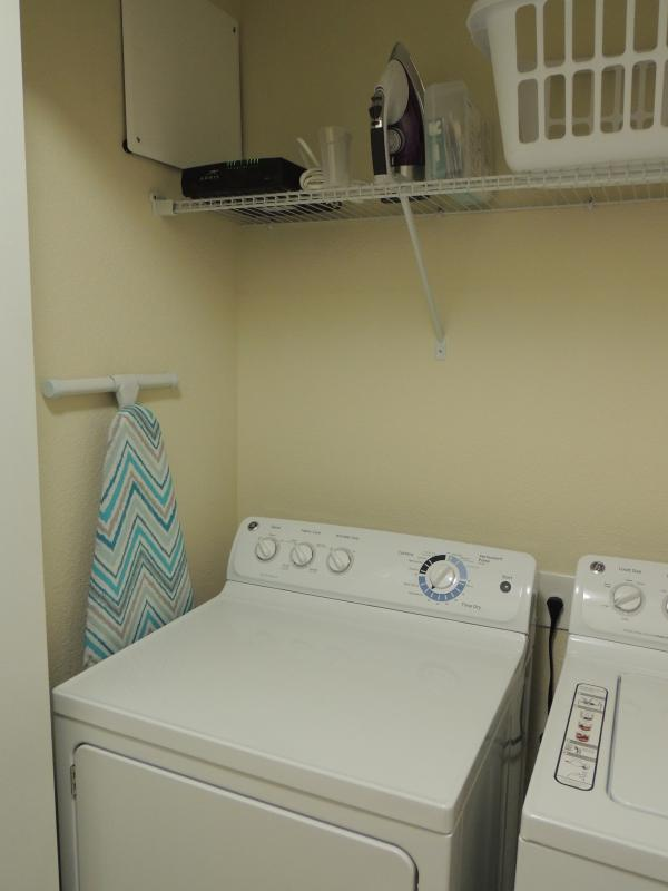 The townhouse laundry area has washer, dryer, iron, and ironing board for guest convenience.