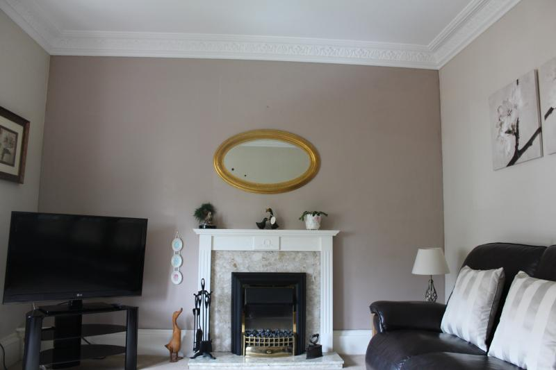 Large Lounge with reclining sofas and flat sreen TV