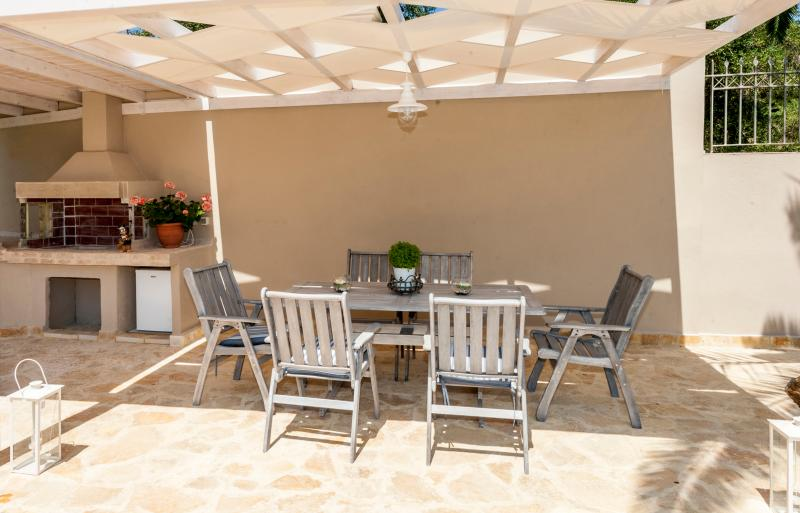 Enjoy a summer barbeque in shaded area.