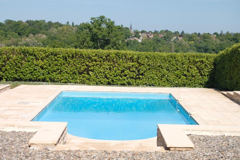 The pool, showing the view over the valley to St Cernin de Labarde