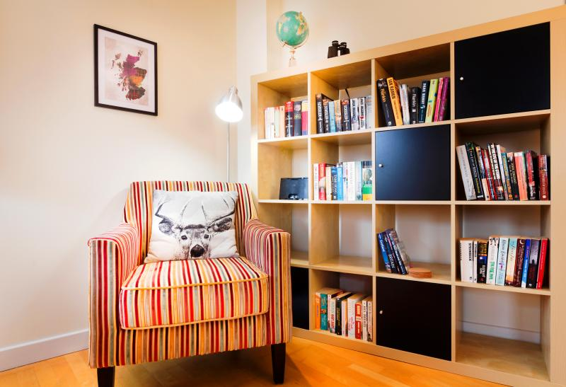A well lit reading area with an iPod docking station. Books, DVDs and games are in the flat