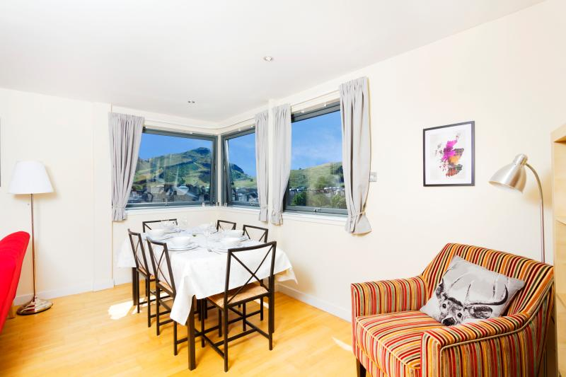 Living room dining table with views over Holyrood Park (all 650 acres of it!) to Arthur's Seat