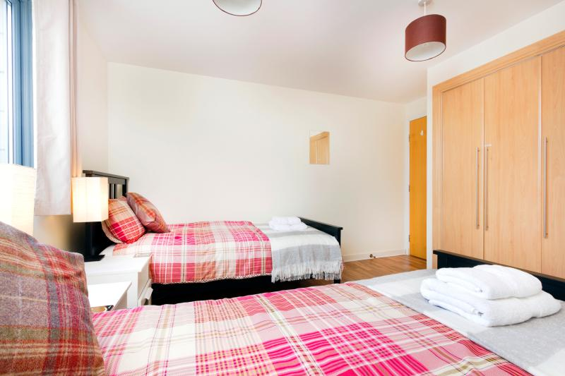 The 2nd bedroom is spacious and has built in wardrobes