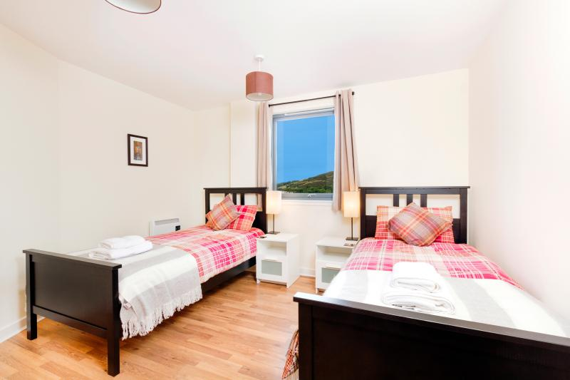 The 2nd bedroom easily holds 2 single beds and has views of Holyrood Park, 3mins walk away