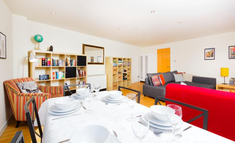 A spacious living Rm (400SqFt) with full sized dining table. Books, DVDs and games are provided