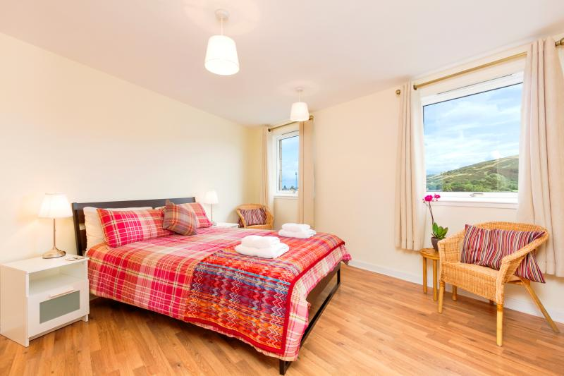 A sizeable master bedroom (King sized bed) with seating space to admire the fantastic views