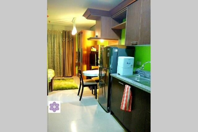 a glimpse of the kitchen going to nook