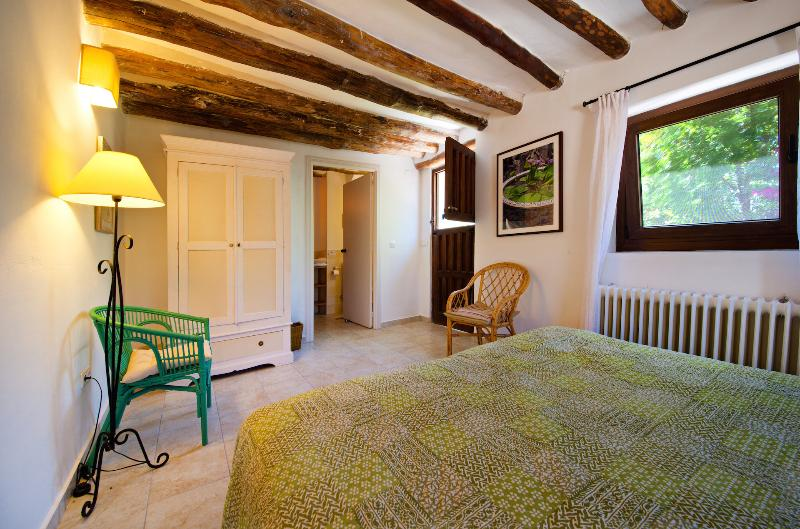 The Olive bedroom - view to garden door and ensuite (double or twin)