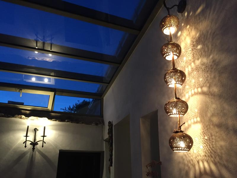 Enjoy star-gazing from the interior patio at night with romanic lighting