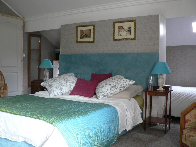 Room 2 with walkaround wardrobe, a balcony and an ensuite shower room and extra single bed