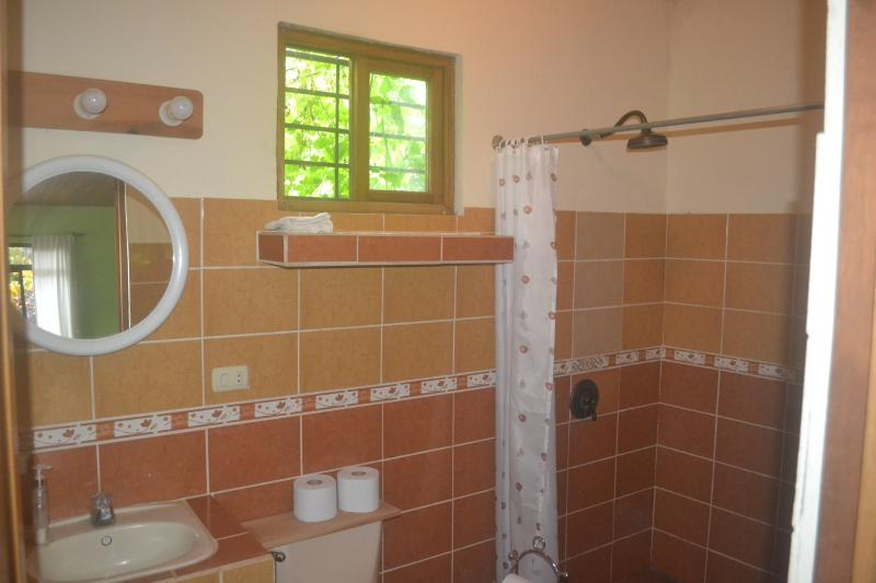 Beautiful tiled bathroom with hot water