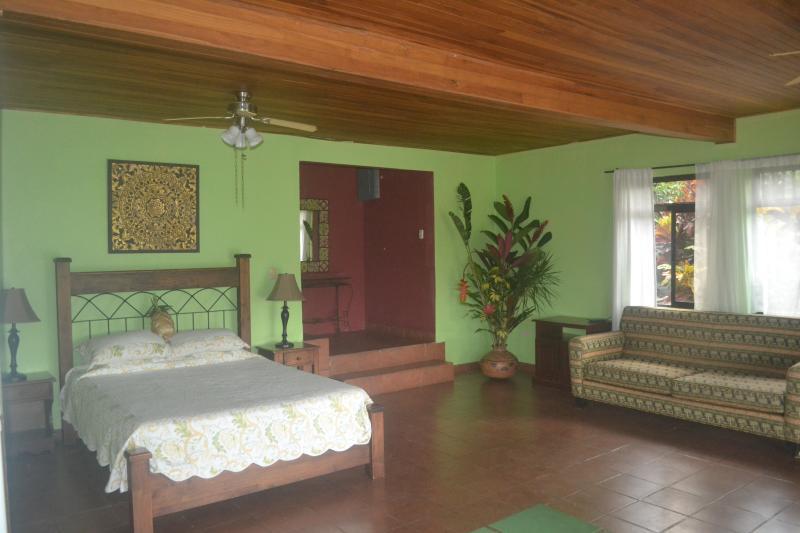 Queen size bed in main room, double bed in back bedroom