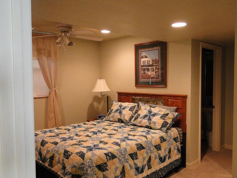 Basement bedroom with queen bed and private bath