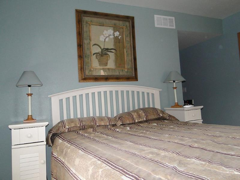 Second floor bedroom with queen bed and private bath