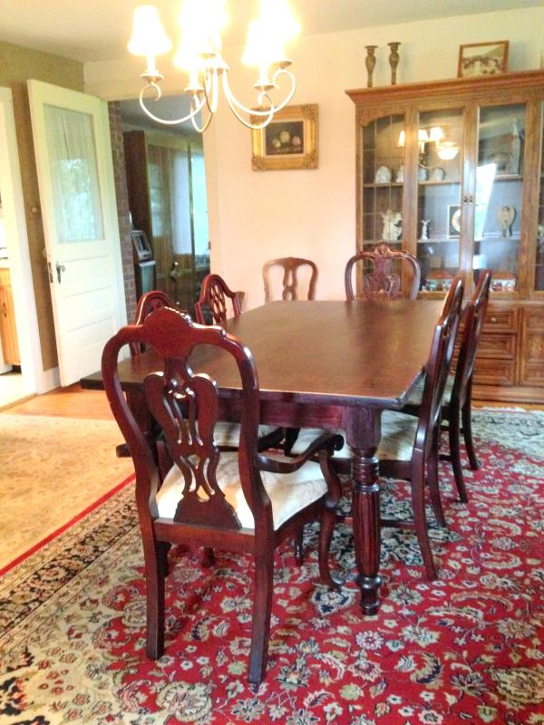 Formal Dining Room - Seating for 8, air-conditioning, persian rug.