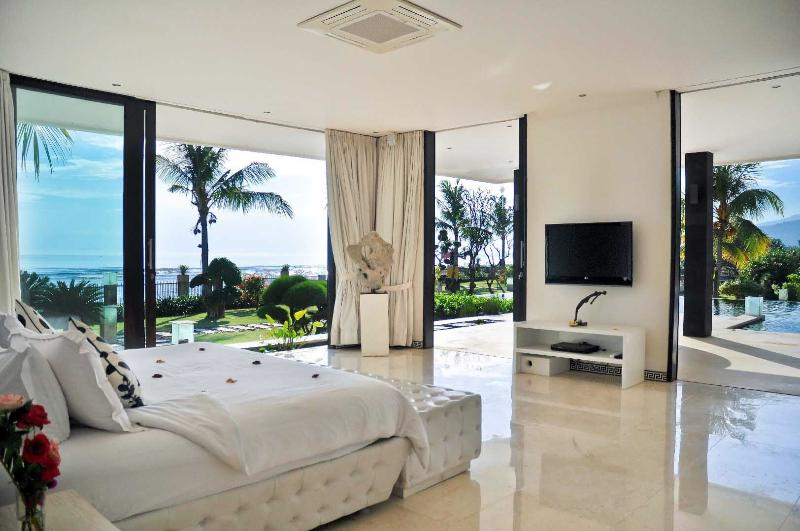 Master bedroom with view over Bali Sea and infinity pool