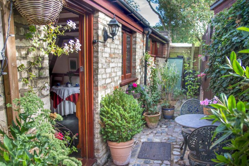 The front door of the Stables - flowers round you door