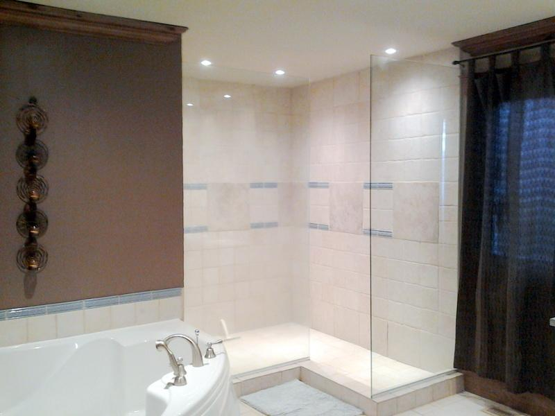 Large bathroom with large corner tub, walk in jet showe, double sinks and vanity