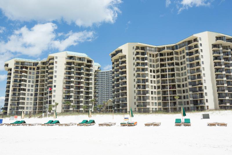 Smack Dab on the Beach with endless views of white sand and water.