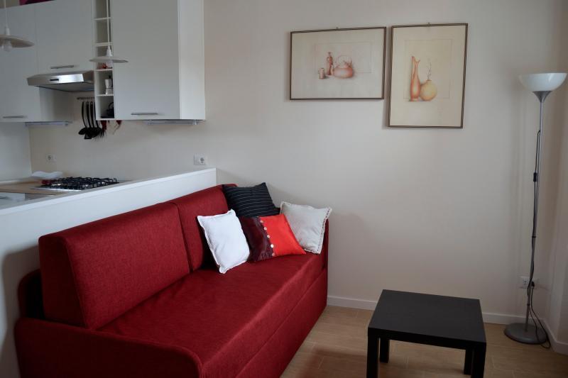 Zona salotto con divano letto