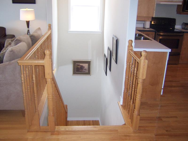 stairs to lower level-between kitchen and living room