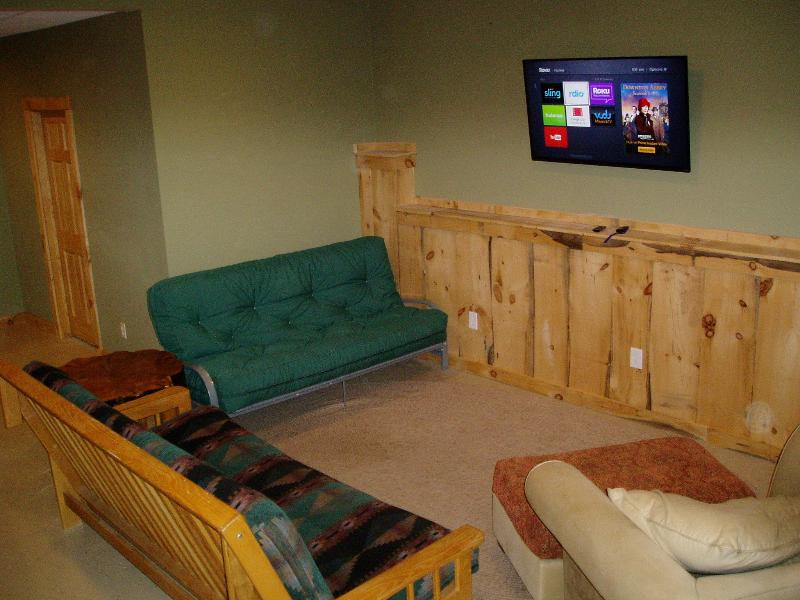 50' tv with cable and a Roku in the game room