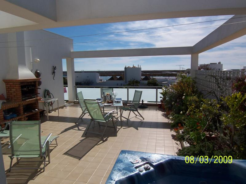Large private terrace with Jacuzzi. Long view to Isla de Tavira