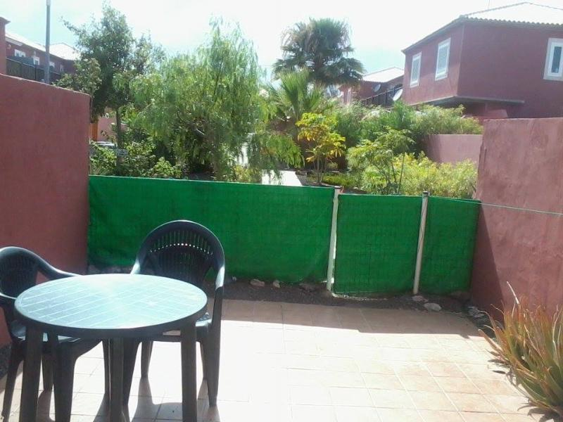Private back garden with views of communal gardens + access to pool